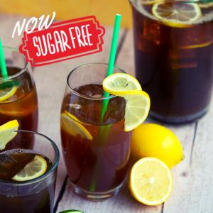 Image of sugar free peach iced tea glass with lemon garnish and straw