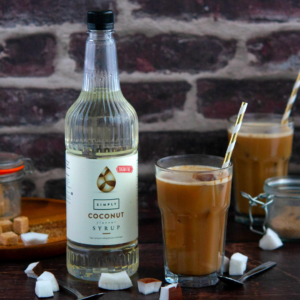 Image of coconut iced mocha with star and simply coconut syrup bottle in the background